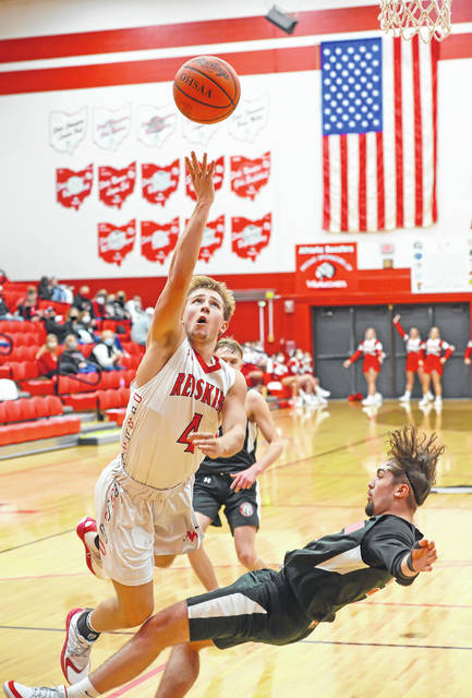 Wapakoneta's Kaden Siefring is called for a charge against Bellefontaine's Noaln Smith during Tuesday's game at Wapakoneta High School.