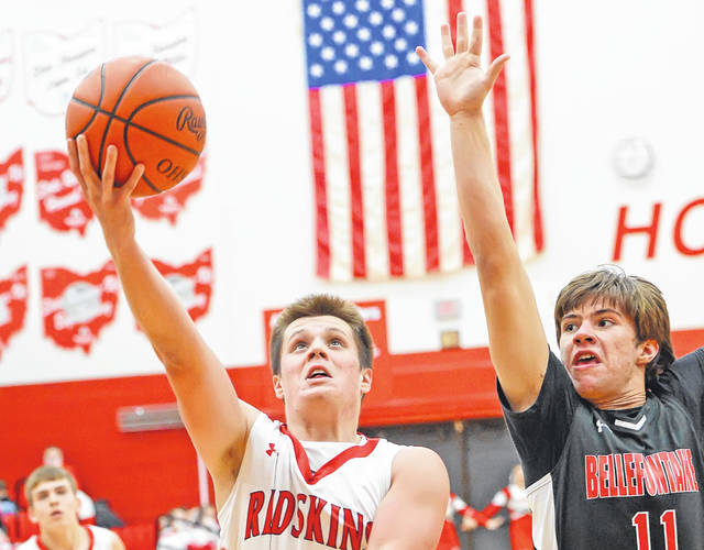 Wapakoneta's Noah Ambos puts up a shot over Bellefontaine's Jack Hutchins during Tuesday's game at Wapakoneta High School.