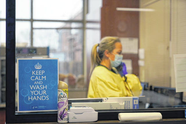 Registered nurse Chrissie Burkhiser works in the emergency room at Scotland County Hospital in Memphis, Mo. Scientists say there is reason for concern but not alarm about new strains of the coronavirus, especially the one currently spreading in England.