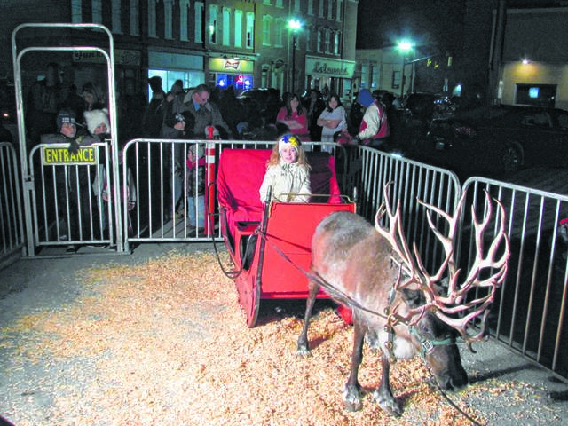 Aubrey Fairchild gets ready to take one of Santa's reindeer for a test run at a past Kiwanis Hometown Christmas in Delphos.
