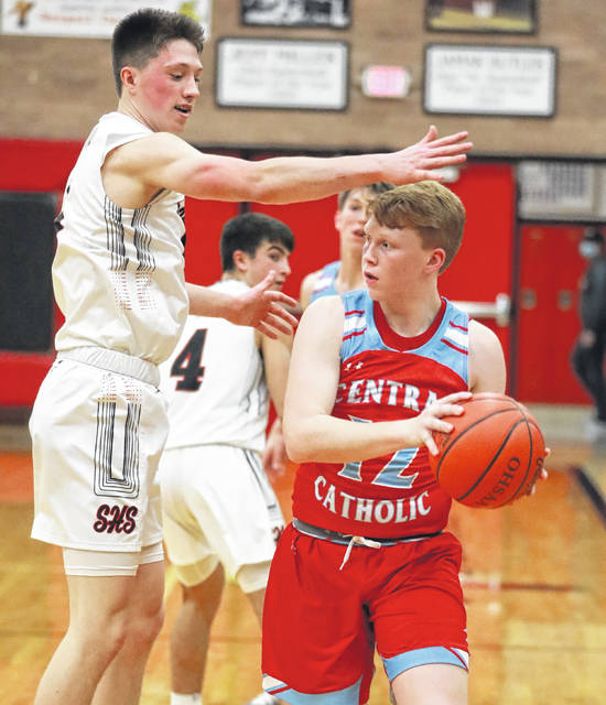 Lima Central Catholic's Nate Stolly tries to maneuver his way around Shhawnee's Jarin Bertke against Shawnee Wednesday.
