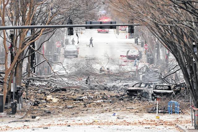 Emergency personnel work near the scene of an explosion in downtown Nashville, Tenn., Friday. Buildings shook in the immediate area and beyond after a loud boom was heard early Christmas morning.