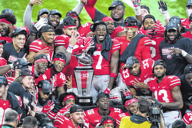 Members of Ohio State celebrate after defeating Northwestern in the Big Ten championship game. A win against Clemson on Friday night will put them in the national title game.