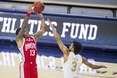 Ohio State's CJ Walker (13) puts up a shot against Notre Dame's Prentiss Hubb (3) during Tuesday night's game in South Bend, Ind. Ohio State won 90-85. (AP Photo)
