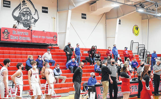 Those allowed to attend a recent Crestview at Bluffton boys basketball game sport masks.