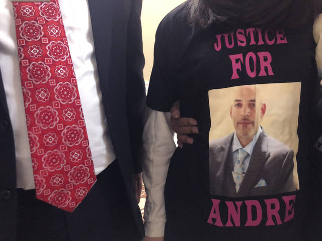 "Andre Hill, fatally shot by Columbus police on Dec. 22, is memorialized on a shirt worn by his daughter, Karissa Hill, on Thursday in Columbus, Ohio. Karissa Hill said she considered her father an ""everything man"" because he did so many things."
