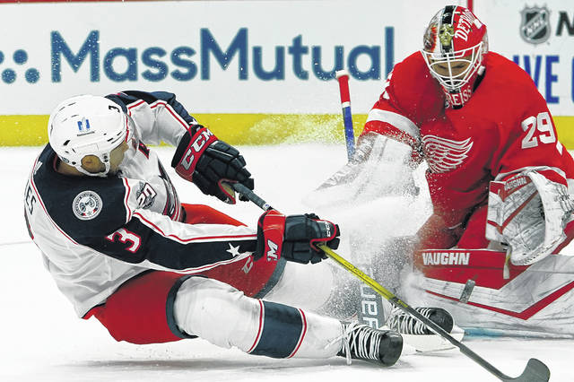 Detroit Red Wings goaltender Thomas Greiss (29) stops a Columbus Blue Jackets' Seth Jones shot in the first period of an NHL hockey game Monday, Jan. 18, 2021, in Detroit. (AP Photo/Paul Sancya)