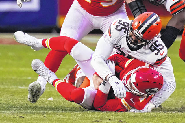 Kansas City Chiefs quarterback Chad Henne is sacked by Cleveland Browns defensive end Myles Garrett (95) during the second half of an NFL divisional round football game, Sunday, Jan. 17, 2021, in Kansas City. (AP Photo/Charlie Riedel)