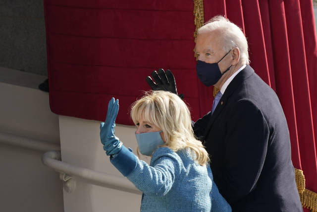 President Joe Biden and first lady Jill Biden, walk out after participating in the 59th Presidential Inauguration at the U.S. Capitol in Washington, Wednesday, Jan. 20, 2021.(AP Photo/Carolyn Kaster)