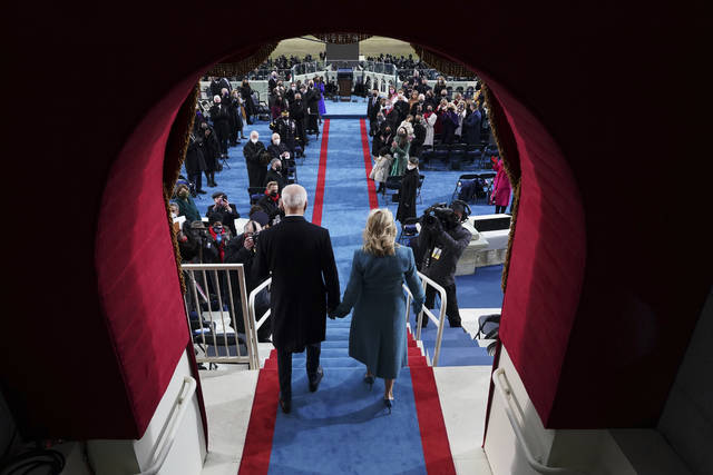 President-elect Joe Biden's and Dr. Jill Biden arrive his inauguration at the U.S. Capitol in Washington, Wednesday, Jan. 20, 2021. (Chang W. Lee/The New York Times via AP, Pool)