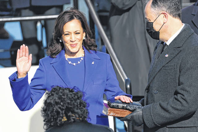 Kamala Harris is sworn in as vice president by Supreme Court Justice Sonia Sotomayor as her husband, Doug Emhoff, holds the Bible during the 59th Presidential Inauguration at the U.S. Capitol in Washington on Wednesday.