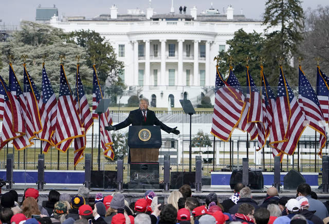 With the White House in the background, President Donald Trump speaks at a rally Jan. 6 in Washington. More Republican senators have raised doubts they'd support impeaching Trump.