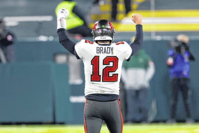 Tampa Bay Buccaneers quarterback Tom Brady reacts after winning the NFC championship NFL football game against the Green Bay Packers in Green Bay, Wis., Sunday, Jan. 24, 2021. The Buccaneers defeated the Packers 31-26 to advance to the Super Bowl. (AP Photo/Jeffrey Phelps)