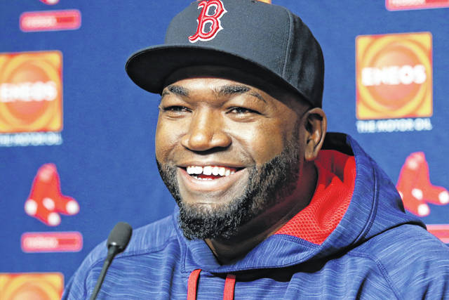 """FILE - In this Sept. 27, 2016, file photo, Boston Red Sox designated hitter David Ortiz laughs during a press conference at Yankee Stadium in New York. Actor John Krasinski and the retired Red Sox slugger announced Sunday, April 12, 2020, during Krasinski's """"Some Good News"""" YouTube show that workers at Beth Israel Deaconess Medical Center in Boston would be getting free Red Sox tickets. (AP Photo/Kathy Willens, File)"""