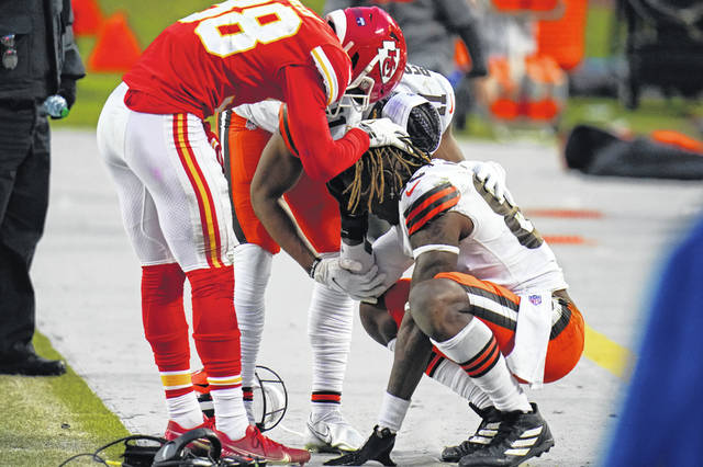 Kansas City Chiefs safety L'Jarius Sneed, left, consoles Cleveland Browns tight end David Njoku, right, after the Chiefs'22-17 win over the Browns in an NFL divisional round football game on Sunday in Arrowhead Stadium in Kansas City.