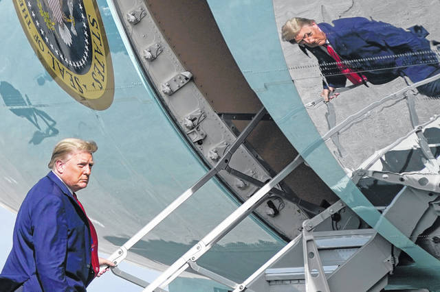 President Donald Trump boards Air Force One at Palm Beach International Airport, Thursday, Dec. 31, 2020, in West Palm Beach, Fla. Trump is returning to Washington after visiting his Mar-a-Lago resort.