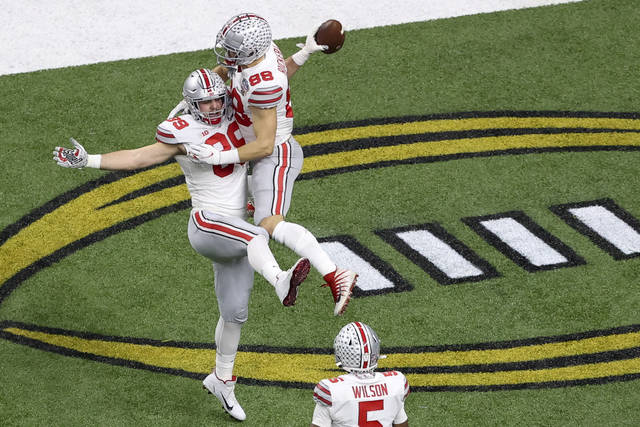 Ohio State tight end Luke Farrell celebrates after scoring with tight end Jeremy Ruckert during the first half of the Sugar Bowl NCAA college football game against Clemson Friday in New Orleans. (AP Photo/Butch Dill)