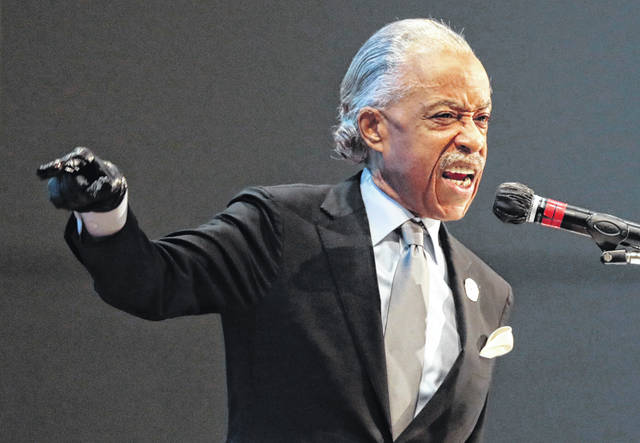 The Rev. Al Sharpton speaks during the funeral of Andre Hill on Tuesday, Jan. 5, 2021 at First Church of God in Columbus, Ohio. Hill, a 47-year-old Black man, was shot and killed by Columbus Division of Police Officer Adam Coy in the early morning of Dec. 22, 2020 after officers responded to a non-emergency call in the area.