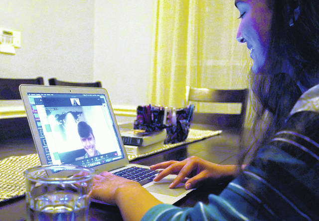 Charvi Goyal, 17, gives an online math tutoring session to a junior high student Monday, Jan. 4, 2021, in Plano, Texas. Goyal is part of a group of high school students that put together their own volunteer online tutoring service to help k-12 during the pandemic.