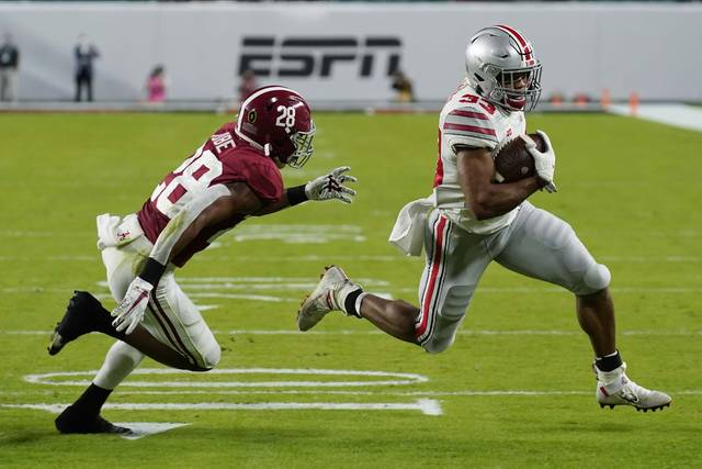 Ohio State running back Master Teague III runs for touchdown past Alabama defensive back Josh Jobe during the first half of an NCAA College Football Playoff national championship game, Monday in Miami Gardens, Fla.