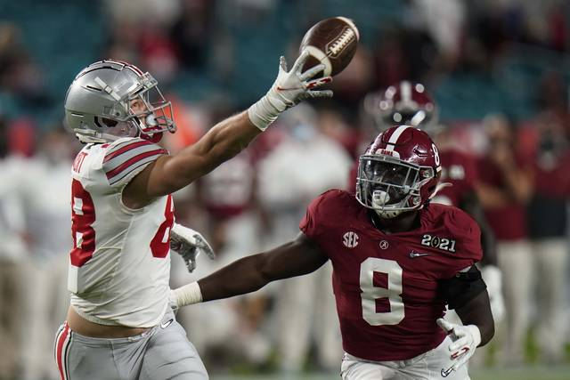 Ohio State tight end Jeremy Ruckert catches a pass in front of Alabama linebacker Christian Harris during the first half of an NCAA College Football Playoff national championship game, Monday 2021, in Miami Gardens, Fla.