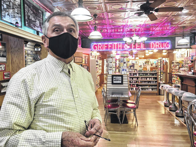 Pharmacist Ric Griffith stands in his family's business Friday, Jan. 15, 2021, in Kenova, W.Va. Griffith & Feil is among 250 mom-and-pop pharmacies in West Virginia helping to vaccinate residents in the quest to banish the coronavirus pandemic.