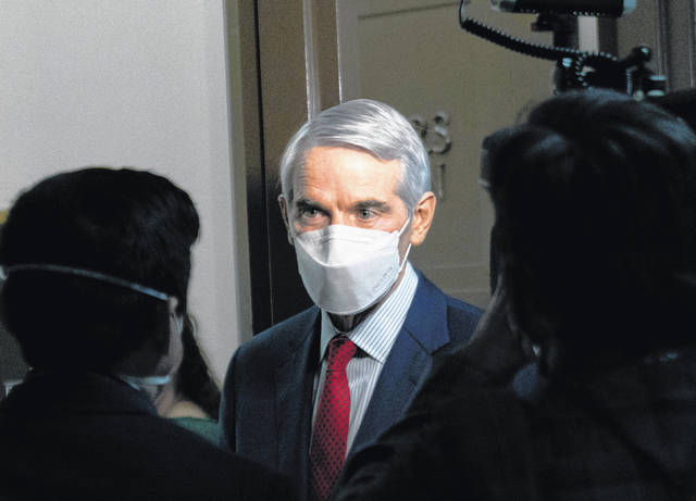 FILE - In this Jan. 19, 2021 file photo, Sen. Rob Portman, R-Ohio, speaks to members of the media outside a Senate Finance Committee hearing on Capitol Hill in Washington.