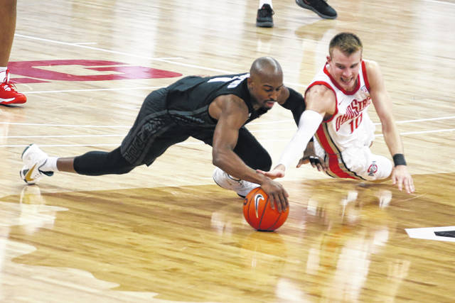 Ohio State's Justin Ahrens, right, and Michigan State's Joshua Langford, fight for a loose ball during OSU's 79-62 win over the Spartans in Columbus on Sunday.