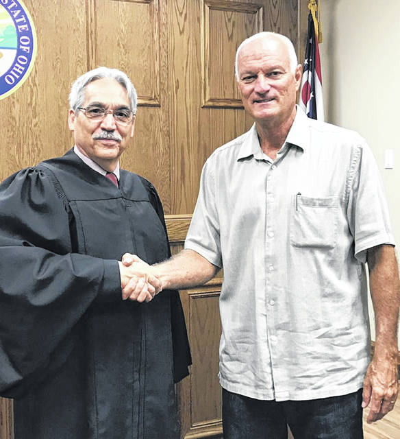Andrew Carey, right, was the second Volunteer Guardian in the history of the Allen County Crime Victim Services program started in 2017. He is pictured with Allen County Probate/Juvenile Court Judge Glenn Derryberry.