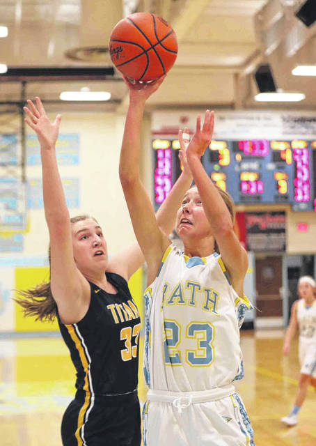 Bath's Ruby Bolon puts up a shot against Ottawa-Glandorf's Erin Kaufman during Thursday night's game at Bath. See more game photos at LimaScores.com.