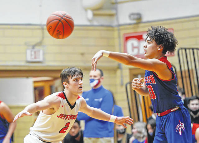 Crestview's JJ Ward makes a pass against Delphos Jefferson's Colin Bailey during Friday night's game in Delphos. Go to LimaScores.com to see more game photos.