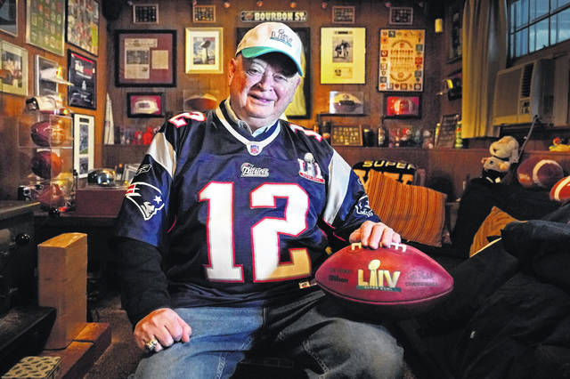 Don Crisman, shown here in his home in Kennebunk, Maine last week, is one of three friends who have attended every Super Bowl. Despite the risk during a pandemic for the three, who are between 79 and 84 years old, they say they can't miss it this year.