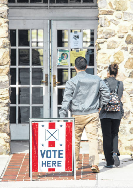 Voters head into the Julian Smith Casino to cast their ballots in Augusta, Ga., Tuesday.