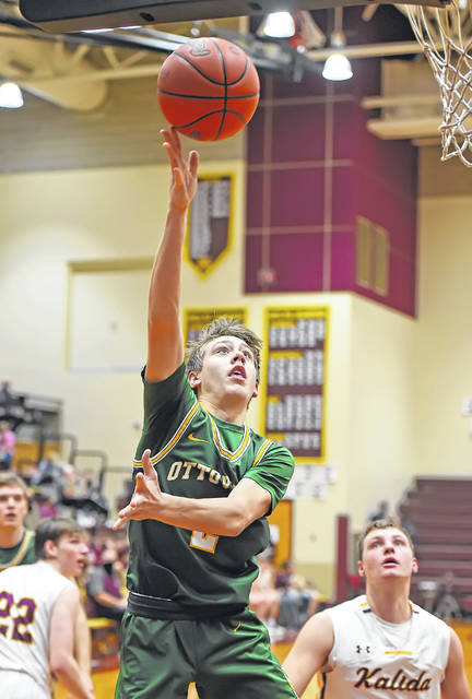 Ottoville's William Miller puts up a shot during Friday night's game at Kalida.