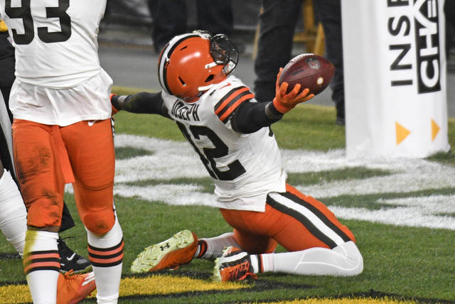 Cleveland Browns strong safety Karl Joseph (42) celebrates after recovering a fumble in the end zone for a touchdown during the first half of an NFL wild-card playoff football game against the Pittsburgh Steelers in Pittsburgh, Sunday, Jan. 10, 2021.
