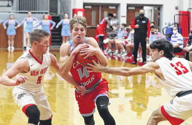 Lima Central Catholic's Evan Unruh gets between Van Wert's Owen Treece (left) and Ethan Brown during Saturday's game at Van Wert. See more game photos at LimaScores.com.