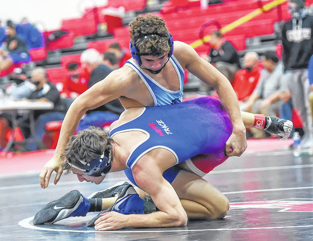 Allen East's Chase Miller, top, wrestles Wayne Trace's Eli Moore during Saturday's Lima Central Catholic Thunderbird Invitational at LCC.