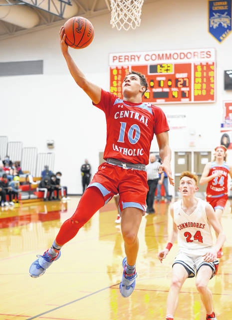 Lima Central Catholic's Rossy Moore puts up a shot against during Saturday's game at Perry.