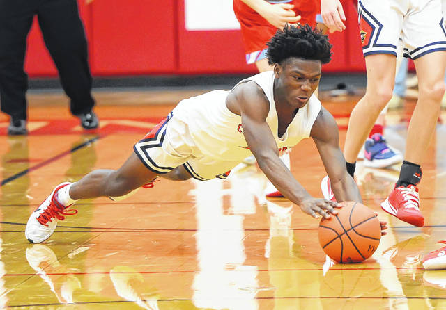 Perry's Terry Riley goes to the floor in trying to retrieve a loose ball during Saturday's game against Lima Central Catholic. See more game photos at LimaScores.com.