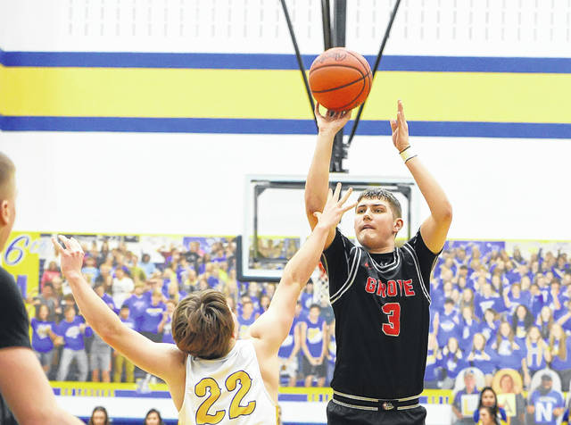 Columbus Grove's Tayt Birnesser puts up a shot against Lincolnview's Landon Price during Tuesday night's game at Lincolnview.