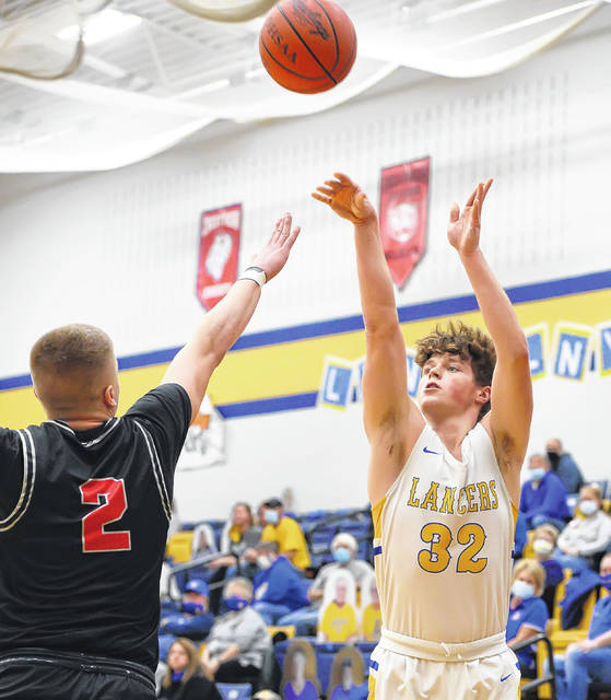 Lincolnview's Creed Jessee puts up a shot against Columbus Grove's Blake Reynolds during Tuesday night's game at Lincolnview.