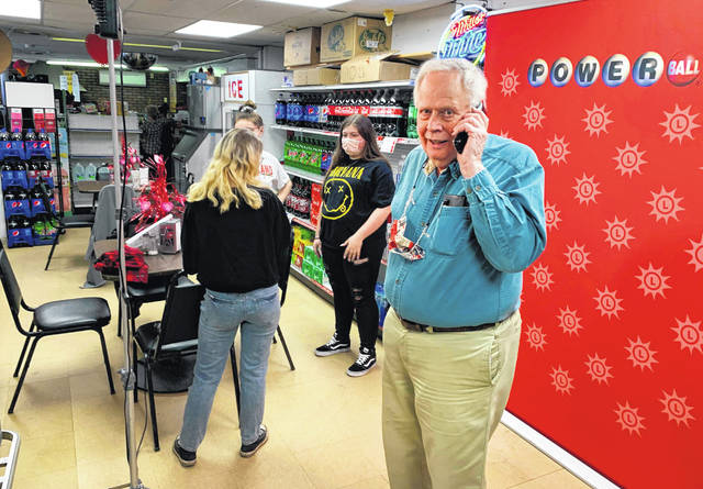Store owner Richard Ravenscroft talks on a phone inside the Coney Market in Lonaconing, Maryland on Thursday, where a jackpot-winning Powerball ticket worth $731 million was sold this week. The store will get a $100,000 bonus for selling the ticket.