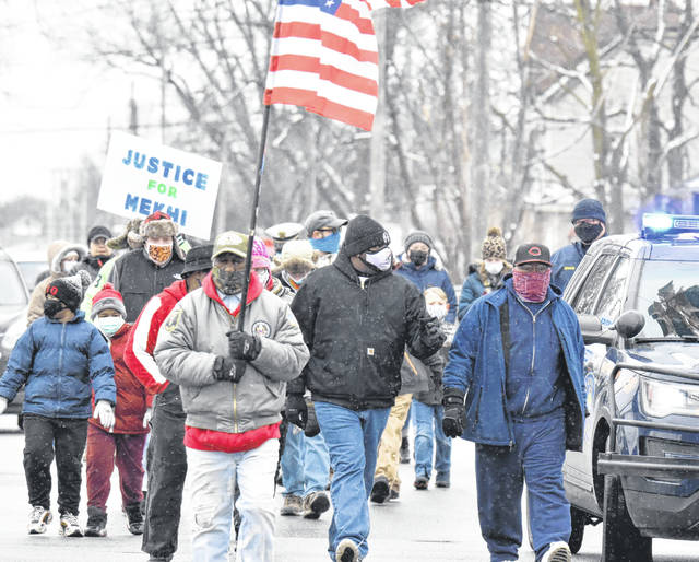 """More than two dozen participants took part Monday in the 12th annual MLK """"March for the Dream"""" walk down Reese Avenue, from Holmes Avenue to the city park that bears King's name."""
