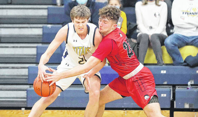Shawnee's Caden Vermillion, right, tries to make a steal against Ottawa-Glandorf's Owen Nichols during Friday night's game at Ottawa-Glandorf. See more game photos at LimaScores.com.