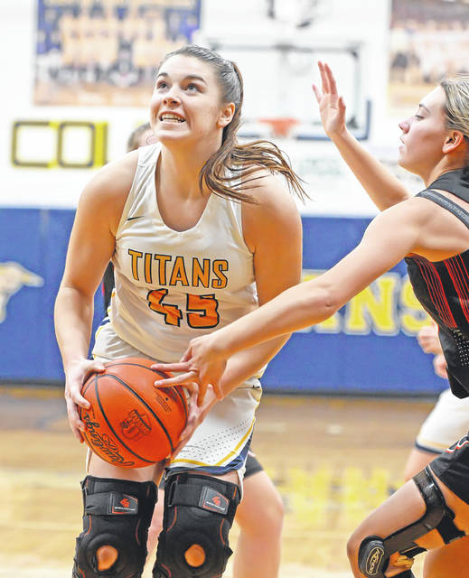 Ottawa Glandorf's Chloee Glenn goes up for a shot against Elida's Hailey Little during Monday's game at Robert J. Hermiller Gymnasium. The Titans claimed the victory, 60-29 to improve to 11-1 on the season and 3-1 in the Western Buckeye League. Elida falls to 6-4 for the year and 2-2 in league play.