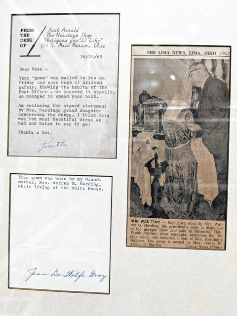 A clipping of The Lima News is included in the display, detailing some of the gown's history.
