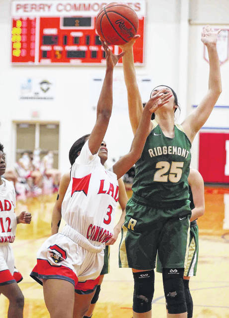 Ridgemont's Hannah Shoffner (25) defends a shot by Perry's Zierre Thompson during Thursday night's game at Perry.