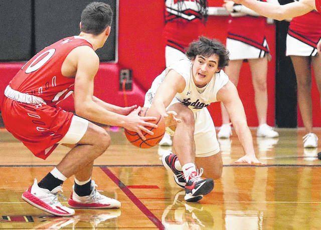 Shawnee's Toby Freiberger tries to get the ball away from Wapakoneta's Braeden Goulet during Friday night's game at Shawnee. See more game photos at LimaScores.com.