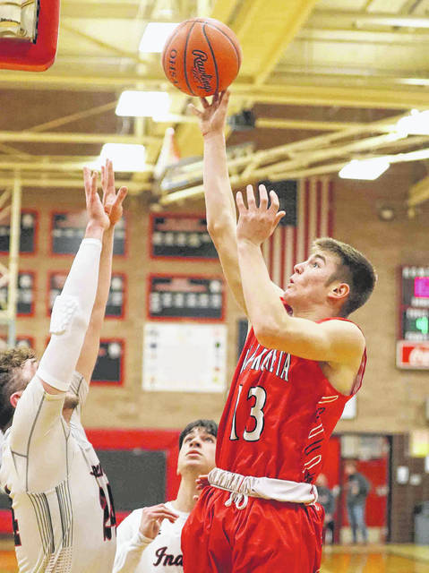 Wapakoneta's Grant Bauer puts up a shot against Shawnee's Caden Vermillion during Friday night's game at Shawnee.