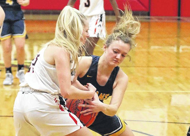 Shawnee's Tessa Stahler, left, and Ottawa-Glandorf's Anna Siefker battle during Thursday night's game at Shawnee. See more game photos at LimaScores.com.